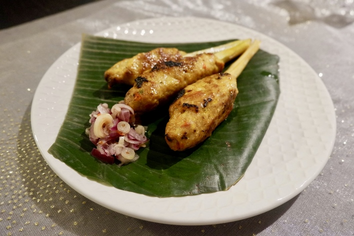 A variety of authentic indonesian food served on banana leaves.